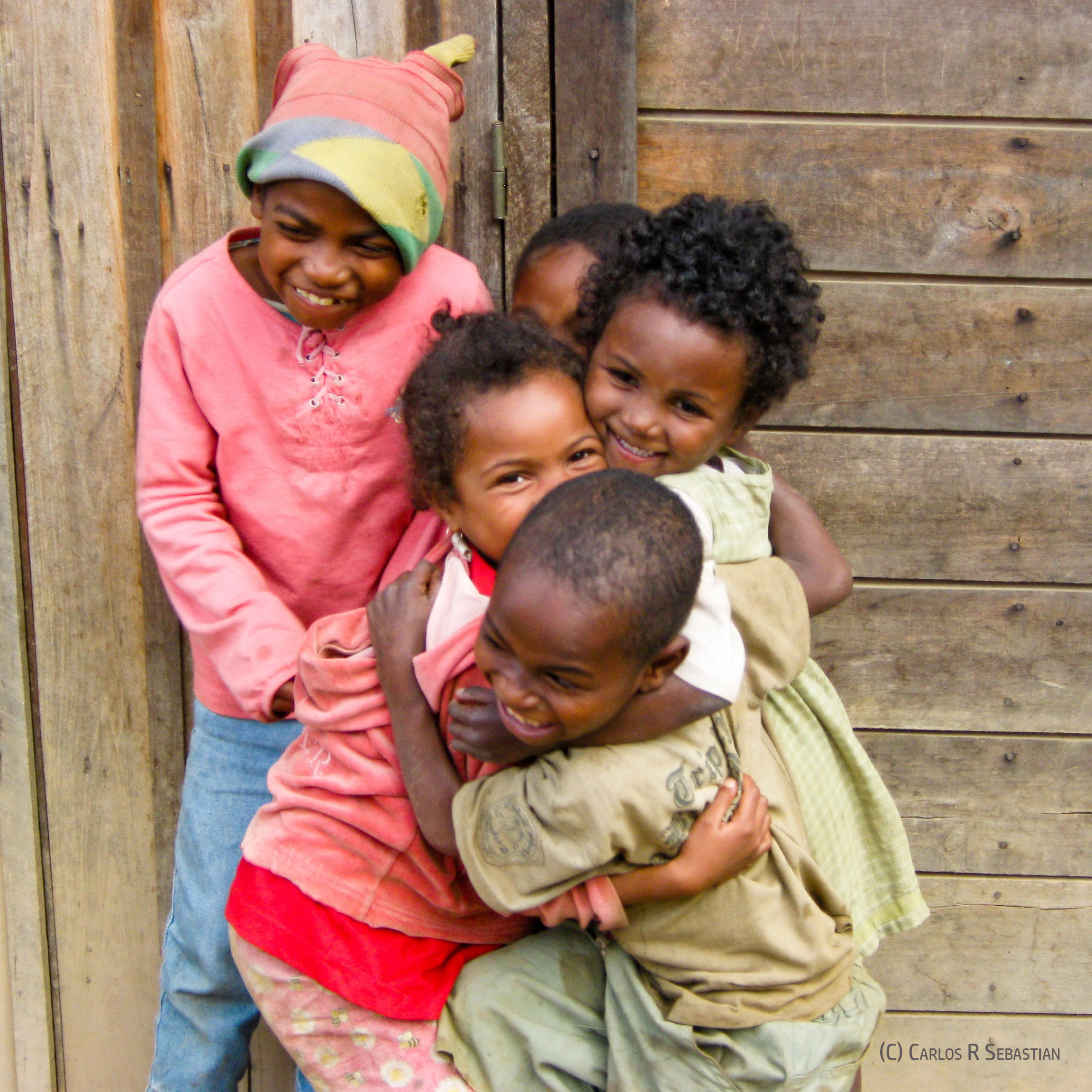 We are all worthy of joy and happiness regardless of what may have happened in our life - Image: Malagasi children hugging and smiling (copyrighted)