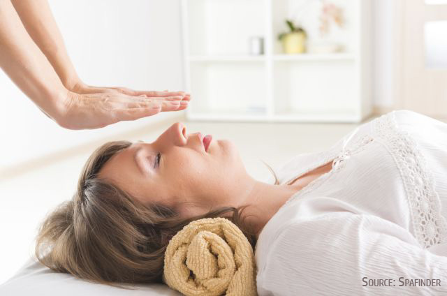 Energy healing is a powerful therapy to balance our enegy systems - Image: Woman receiving energy healing (sourced from Spafinder)